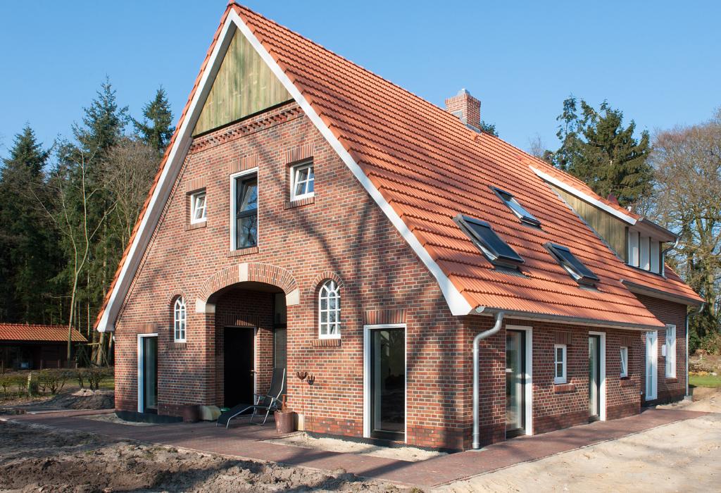 Renovated farm house with a red brick facade